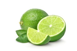 Green lime with cut in half and slices isolated on white background.