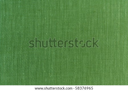 GREEN LINEN FABRIC AS BACKGROUND FOR CHRISTMAS - stock photo