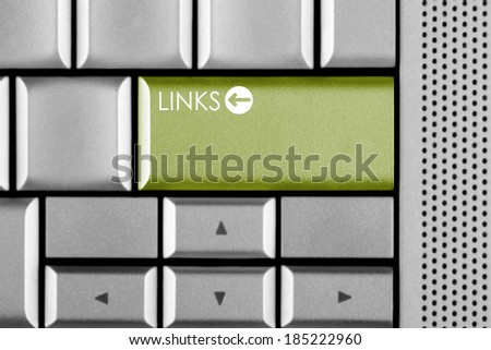 Green LINKS key on a computer keyboard