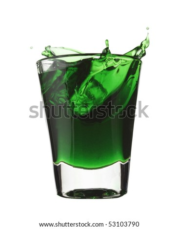 Green liquid, liquor splash in shot glass