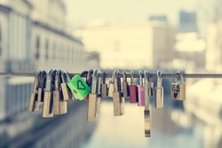Green love lock over the river