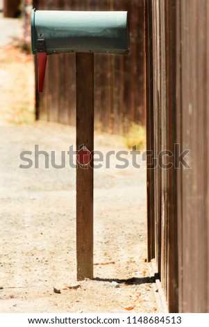 green mailbox in suburbia