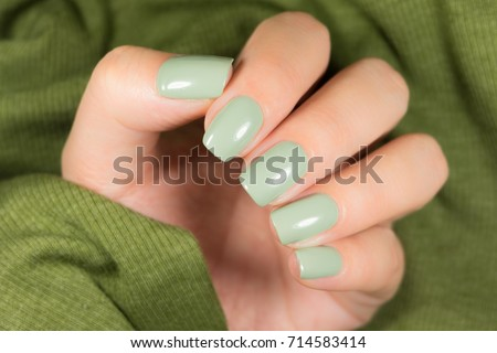 green manicure with a picture of the chip