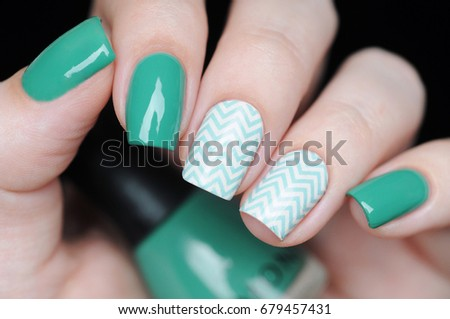 green manicure with zigzag pattern #679457431