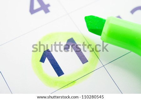 Green marker and open calendar
