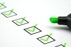 Green marking on checklist box with green pen, Checklist concept