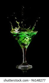 Stock Photo: green martini cocktail splashing into glass