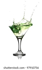 Stock Photo: green martini cocktail splashing into glass on white background
