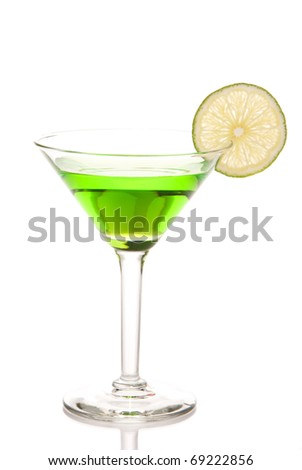 Green martini cocktail with lime wheel, vodka, pineapple juice, liqueur in classic martiny cocktail glass isolated on white background