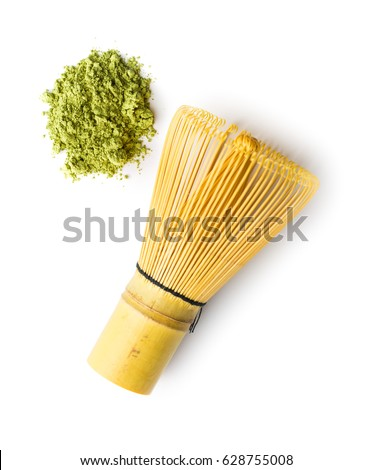 Green matcha tea powder and bamboo whisk isolated on white background. #628755008