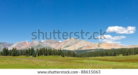 Green Meadow and colorful peaks in the San Juan Mountains along the Colorado Trail.
