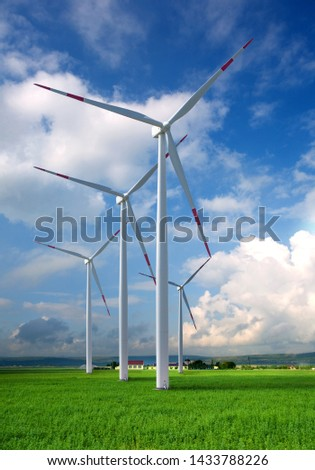 green meadow with Wind turbines generating electricity #1433788226