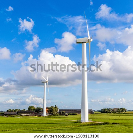 green meadow with Wind turbines generating electricity #1508113100