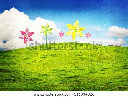Green meadow with wind turbines (pinwheels)