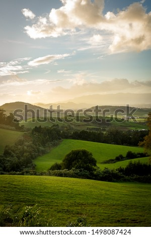 Green meadows on sunset, San Miguel, Azores #1498087424