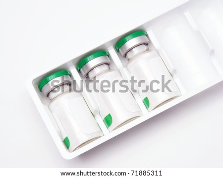 Green medical bottles on white