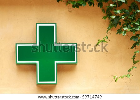 Green medical cross sign