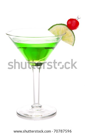 Green melon ball martini alcohol cocktail with vodka, light rum, gin, tequila, blue curacao, lemon juice, lemonade, lime slice, maraschino cherry isolated on a white background