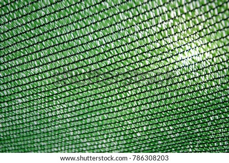 Green mesh sunshade in the garden #786308203