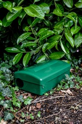 Green Metal external rodent rat bait station outside close up.  Pest Control.
