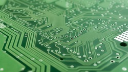 Green microprocessor background, computer motherboard background.