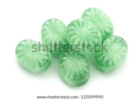 Green mint candies isolated on white background