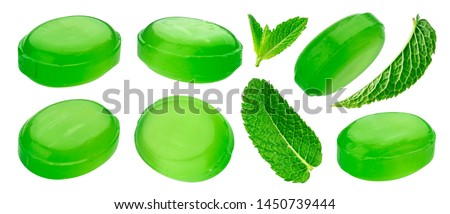 Green mint hard candies isolated on white background with clipping path. Menthol candy and mint leaves, delicious confectionery collection