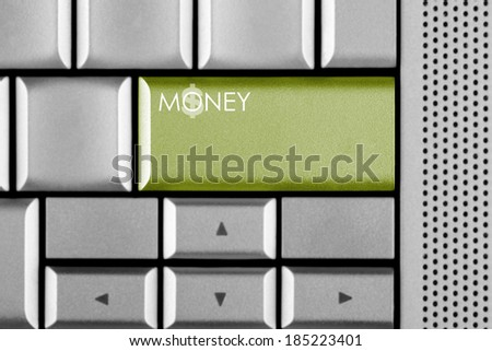 Green MONEY key on a computer keyboard