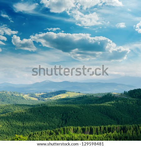 green mountain covered by cloudy sky. Bukovel region, Ukraine