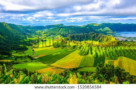 Green mountain valley agriculture fields. Agriculture mountain valley fields landscape. Agriculture valley fields in mountains. Agriculture mountain valley field landscape #1520856584