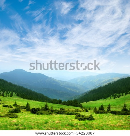 green mountain valley and blue sky with clouds