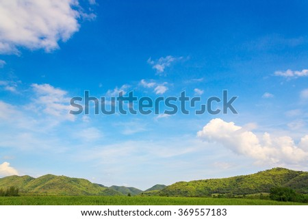 green mountain with cloud and blue sky on sunny day #369557183