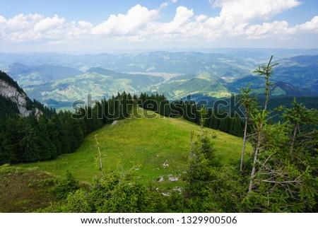 Green mountains in Romania - Rarau Mountains - Campulung Moldovenesc depression valley on a sunny day of summer  #1329900506