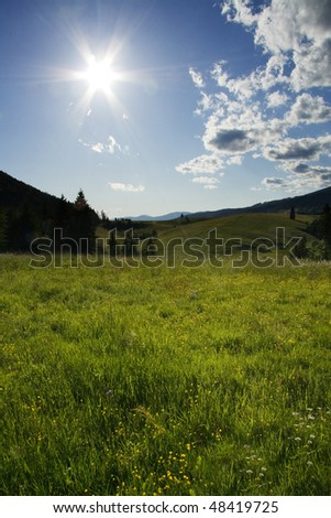 Green Mountains with sun