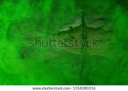 green mystical fog covered pine tree trunk closeup background for design mysticism concept #1358380316