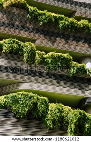 Green nature facade on modern futuristic building in Singapore city