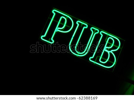 Green neon sign of a Pub