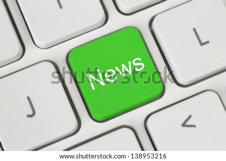 Green news button on keyboard close-up