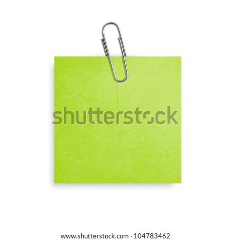 Green Note paper with paper clip on white background.