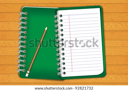 Green notebook and pencil on wooden floor - stock photo