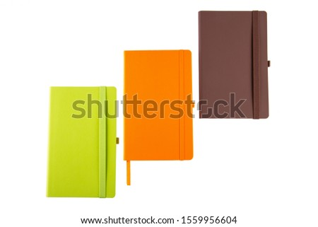 Green Notebook, Orange Notebook and Brown Notebook on White Background #1559956604