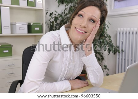 green office: business woman thinking at office