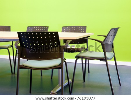 Green office furnished in table and chairs