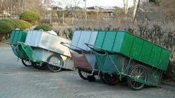 Green old handcarts on the Winter Park Sidewalk