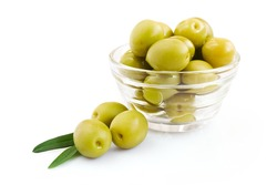 Green olive in a glass bowl isolated over white