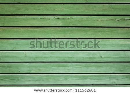 Green olive old painted wooden background