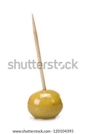 Green olive on a toothpick isolated on a white background