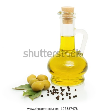 green olives and a bottle of olive oil