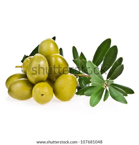 green olives and a branch with leaves isolated on white background
