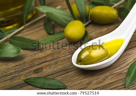 green olives and oil on the spoon